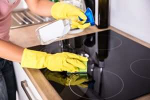 How do you clean a burnt glass stove top