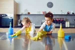 At what age should a child clean up after themselves